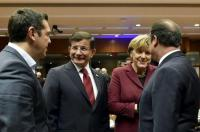 Greece's PM Tsipras, Turkish PM Davutoglu and German Chancellor Merkel talk to French President Hollande during an EU-Turkey summit in Brussels