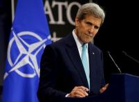 Kerry listens to a question during a news conference at the NATO ministerial meetings at NATO Headquarters in Brussels